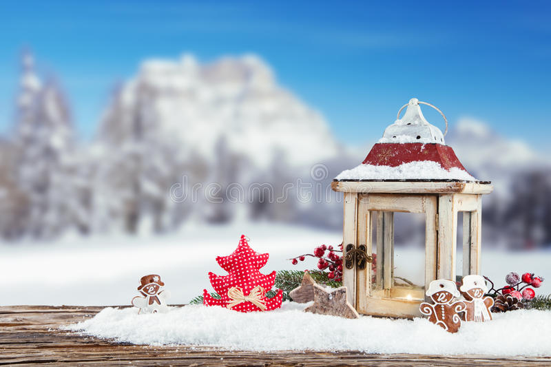Winter snowy scenery with lantern stock photo