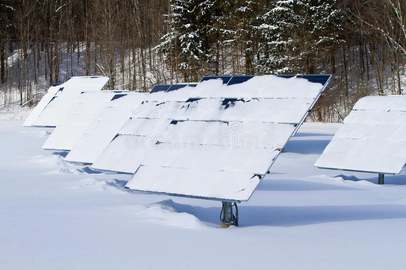 Winter solar panels. Snow covered solar panels on a winter morning royalty free stock image