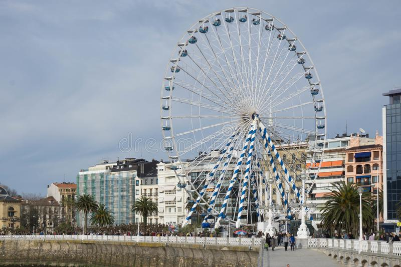 Ferris wheel in San Sebastian. Winter in spain, ferris wheel in Pais Vasco, Spain, ocean coast stock images