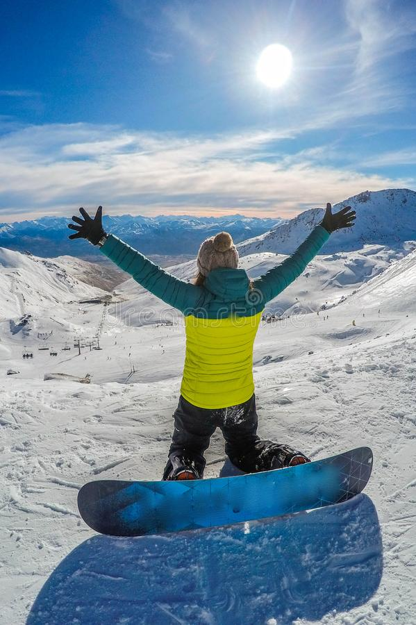 Happy snowboarding girl, Remarkables, New Zealand royalty free stock photography