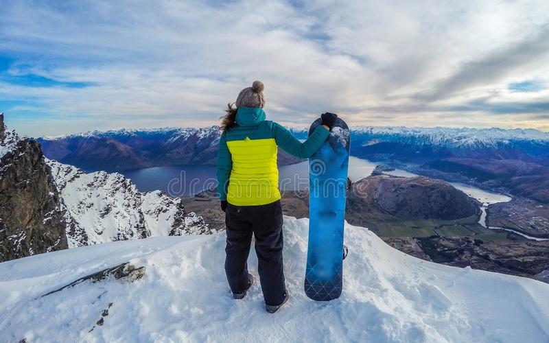 Happy snowboarding girl, Remarkables, New Zealand royalty free stock image
