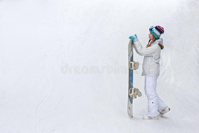 Winter, sport concept, happy young woman with snowboard outdoors royalty free stock images