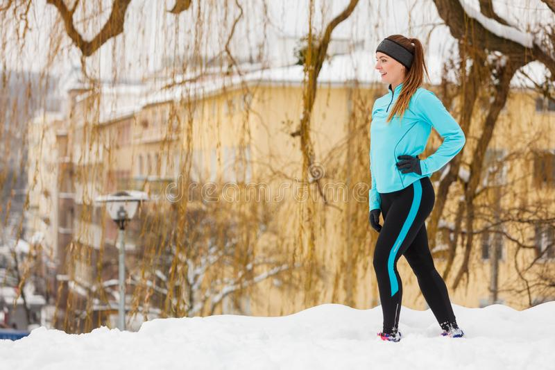 Winter sports, girl exercising in city stock photography