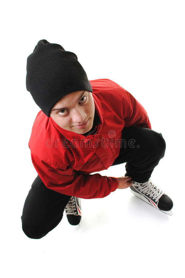 Winter sports teenager tying skates stock photography