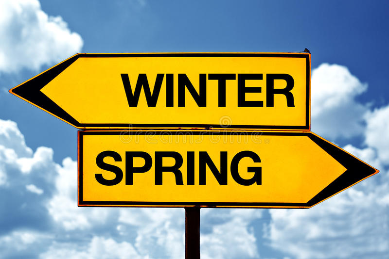 Winter or spring opposite signs royalty free stock images