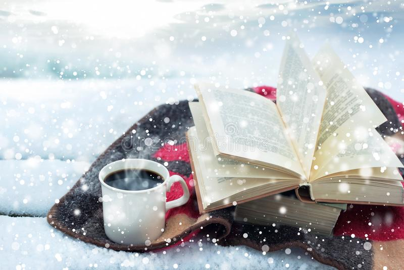 Winter still life: cup of coffee and opened book stock photo