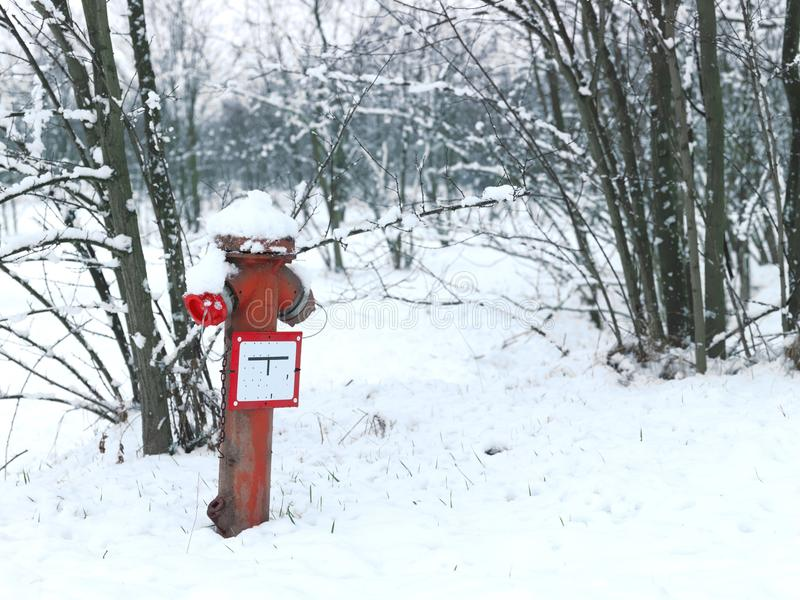 Winter still life with old rusty hydrant royalty free stock photography