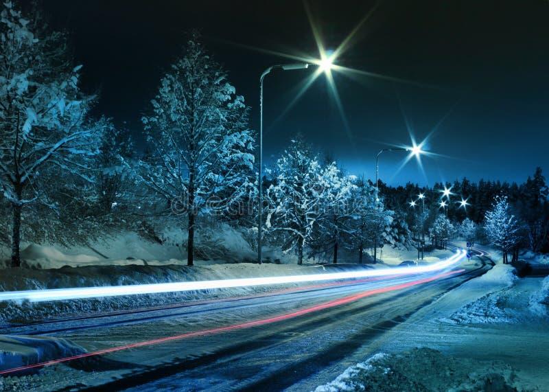 Winter street traffic. Small town street traffic on dark cold winter evening stock photography