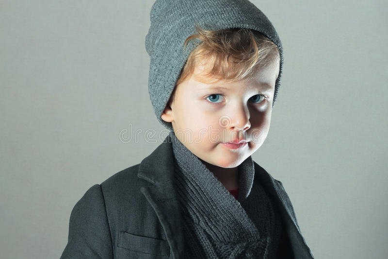 Winter Style Little Boy. Handsome Child. Fashion Kids. cap. Blue eyes stock image