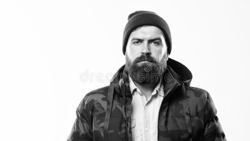 Winter stylish menswear. Man bearded stand warm black jacket parka isolated on white background. Winter outfit. Hipster. Winter fashion. Guy wear hat and black stock photos