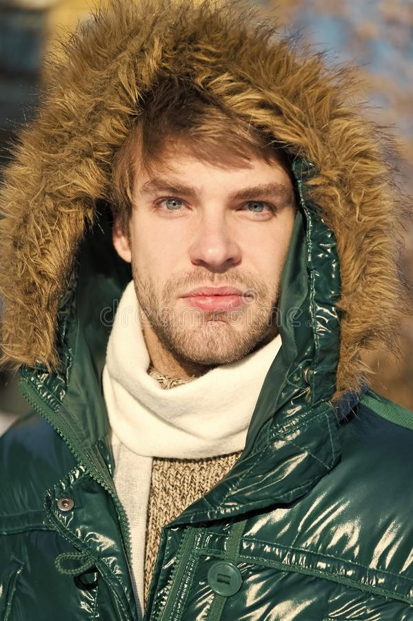 Winter stylish menswear. Winter outfit. Man unshaven wear warm jacket with fur snowy nature background. Guy wear winter. Jacket with furry hood. Hipster winter stock photos