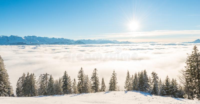 Winter sun on a blue sky. Alps royalty free stock photos