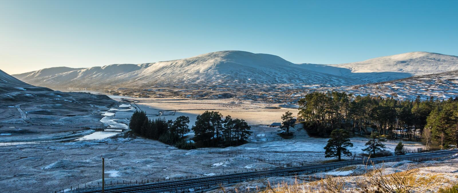 Winter Sun and snow in scotland stock photography