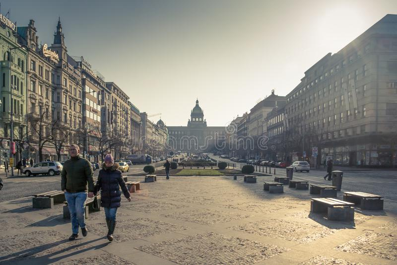 Winter sun view on the Wenceslas Square in Prague, people strolling by stock images