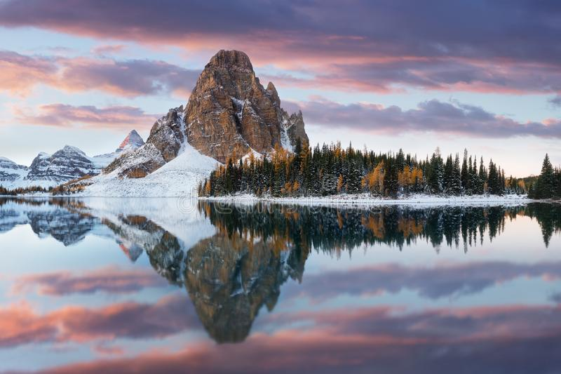 Winter Sunburst peak and lake is located on the Great Divide, on the British Columbia/Alberta border in Canada. Most popular place royalty free stock photo