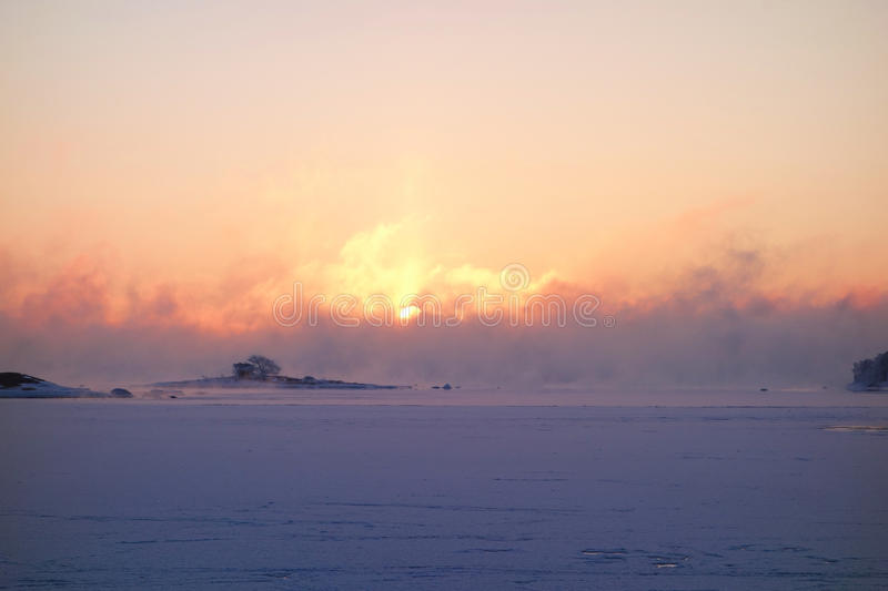 Winter sunrise by the Baltic Sea stock photos