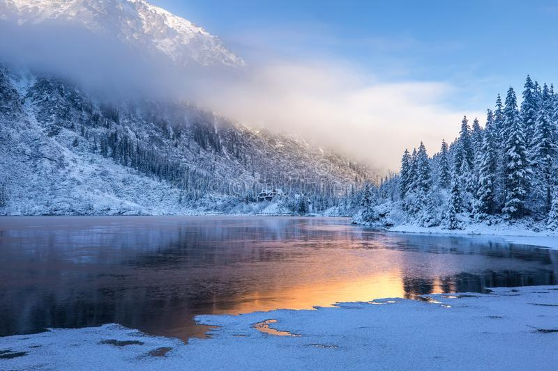 Winter sunrise over scenic frozen lake. In mountains. High Tatras, Poland royalty free stock images