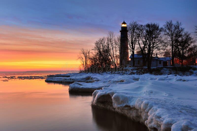 Winter Sunrise Point Aux Barques Lighthouse. Winter sunrise on Michigan Lake Huron shoreline. Point Aux Barques Lighthouse. USA royalty free stock image