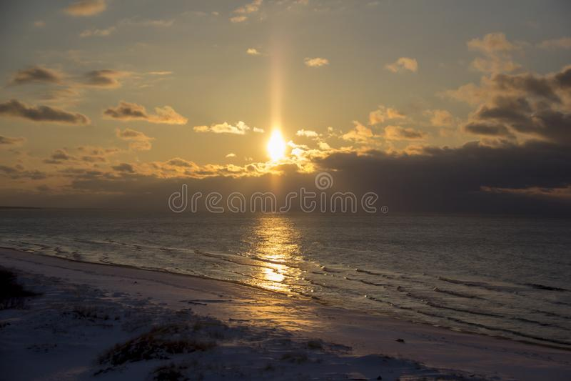 Winter sunrise snow baltic beach, latvia, saulkrasti royalty free stock image