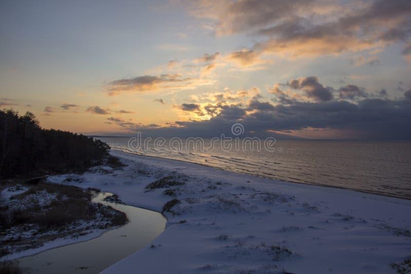 Winter sunrise snow baltic beach, latvia, saulkrasti royalty free stock photos