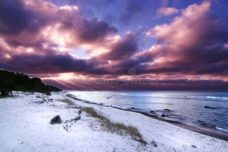 Winter Sunset. Winter time sunset with vibrant purple colors royalty free stock photo