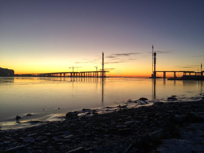 Winter. Sunset on the coast royalty free stock photos