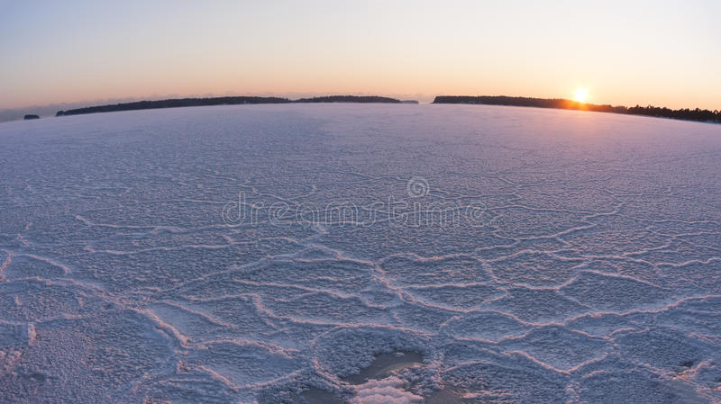Winter sunset at frozen sea royalty free stock photography