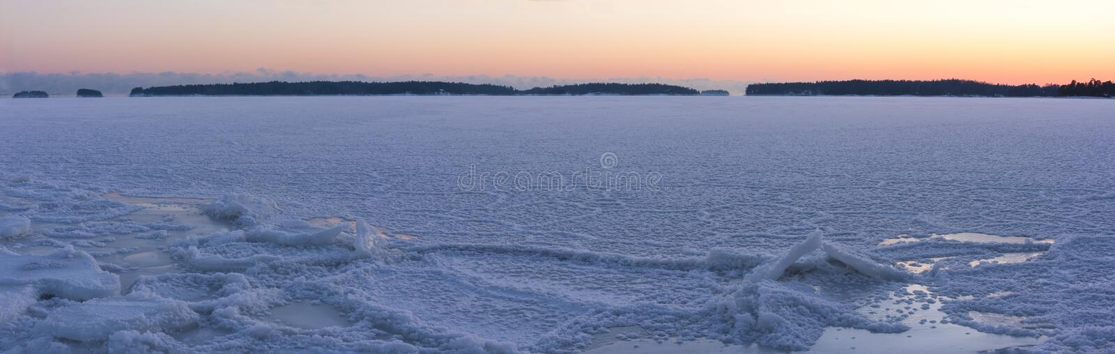 Winter sunset at frozen sea royalty free stock image