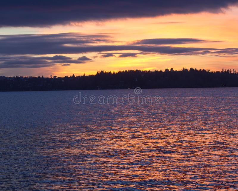 Seattle's skyline from a lake in a winter sunset at Waverly Beach Park, Kirkland, Washington royalty free stock image