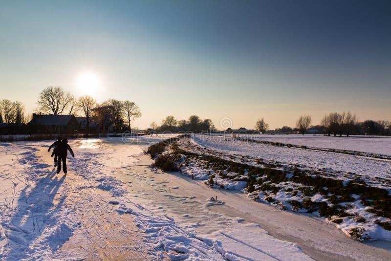 Winter sunset ice skating stock image