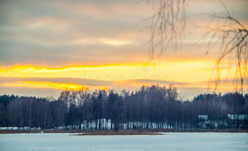 Winter sunset landscape and frozen lake. Winter sunset landscape, Salote lake in Lithuania royalty free stock photos