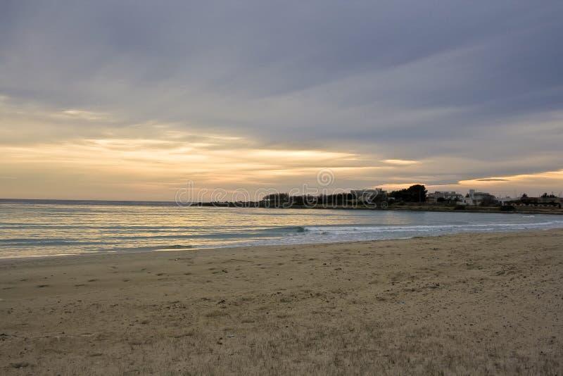 Winter sunset on the sea stock photography