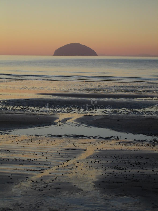Winter sunset shot of the island of Ailsa Craig and Girvan beach, Scotland royalty free stock images