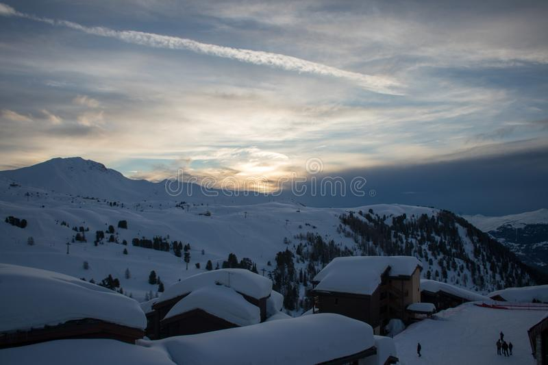 Winter sunset in a snowed mountain villlage. Winter sunset in a snowed mountain village. This picture was taken in French Alps mountains in March 2018 royalty free stock images