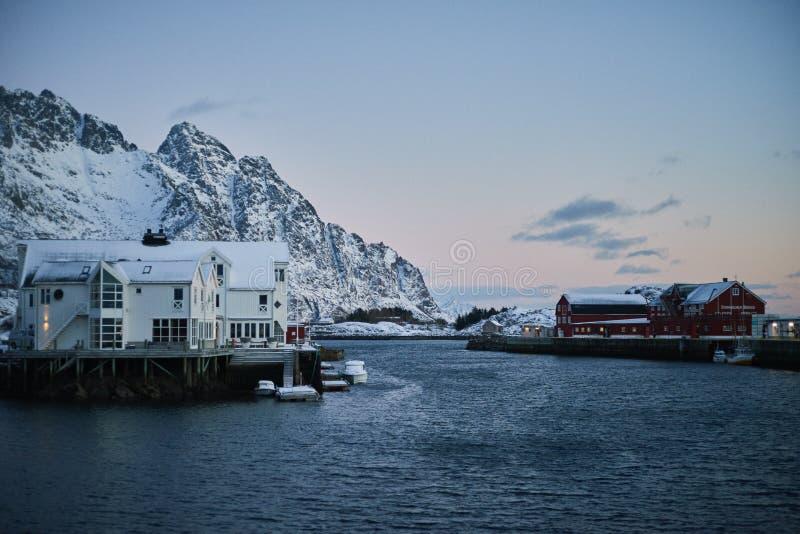 Winter sunset unfrozen sea and Scandinavian houses stock images