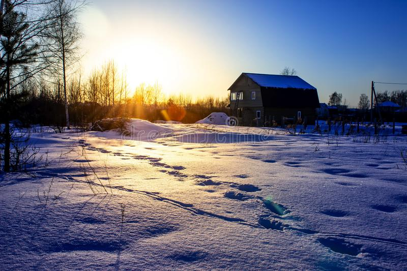 Winter sunset village in cold evening. Russian winter. stock image