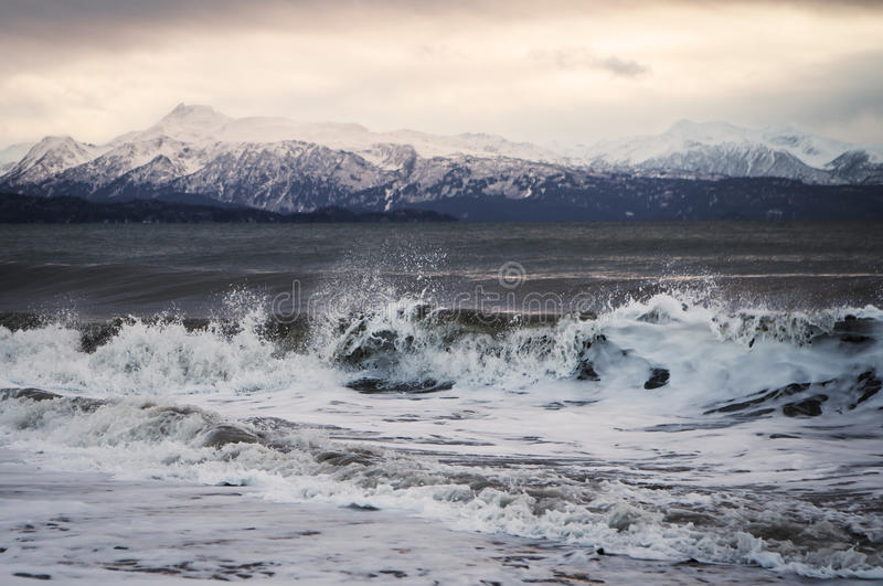 Winter sunset with waves royalty free stock photography