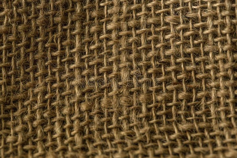 Winter Sweater Design. Natural textured burlap sackcloth hessian texture coffee sack, dark country sacking canvas, macro backgroun royalty free stock photography