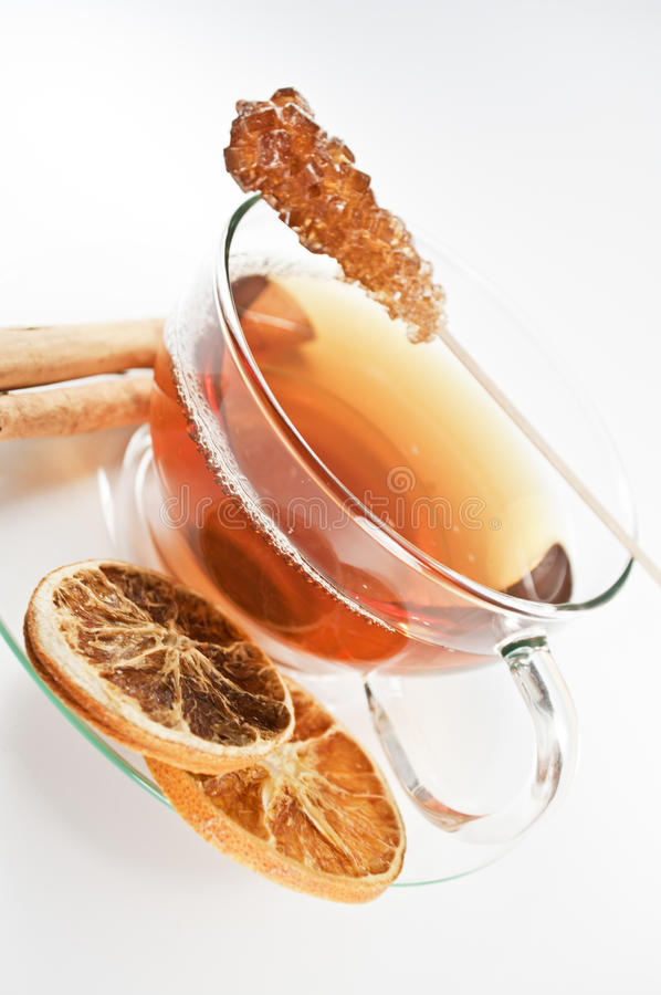 Winter tea. Tea, cinnamon and sugar on white royalty free stock photo