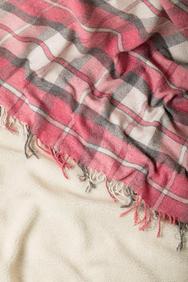 Winter time. A cozy warm pink blanket and a cup of coffee and croissants on the bed. Selective focus royalty free stock photography