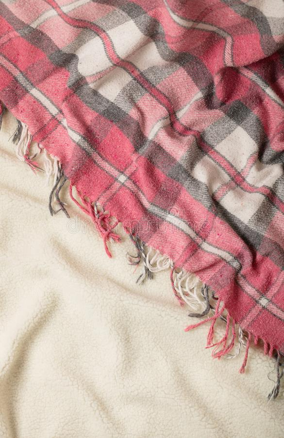 Winter time. A cozy warm pink blanket and a cup of coffee and croissants on the bed. Selective focus stock image