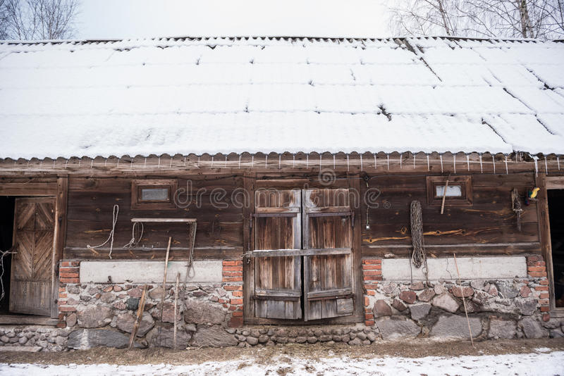 Winter time. Old wooden byre covered with snow in Poland royalty free stock images