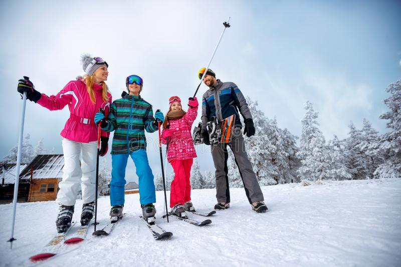 Winter time and skiing - family with ski and snowboard on ski ho stock images