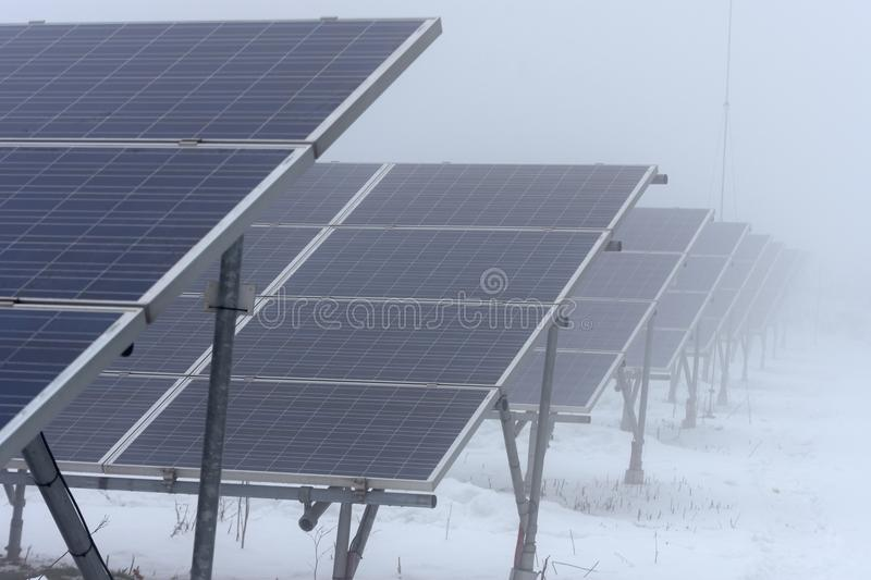 Winter time and solar collectors in fog. And snow stock photography