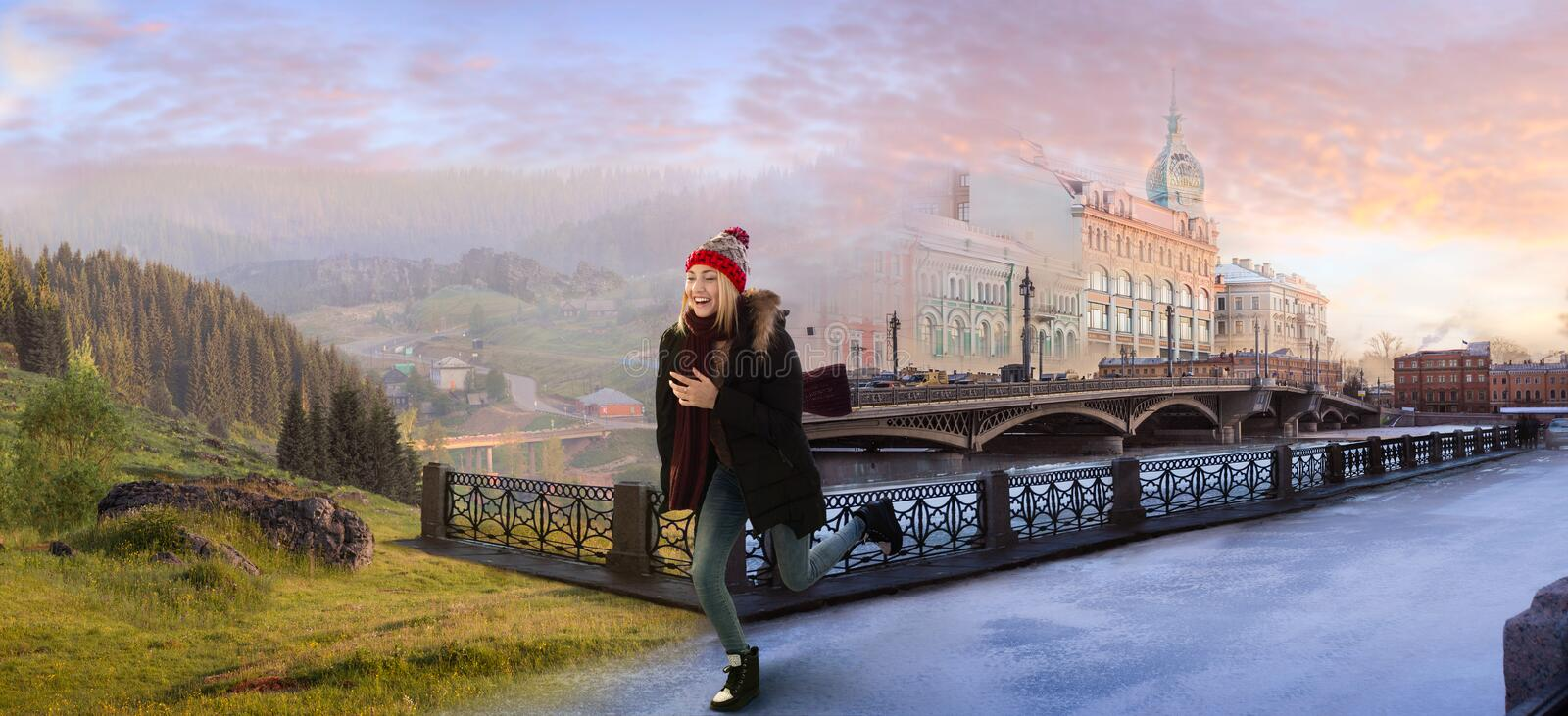 From winter to summer. Young woman crossing the surreal imaginary border between winter city and summer countryside at the dawn. Escape from big city life royalty free stock photography