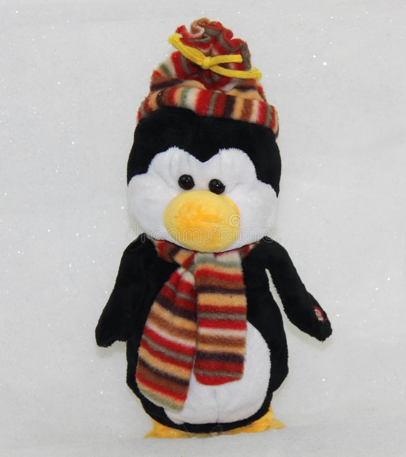 Winter toy penguin stock images