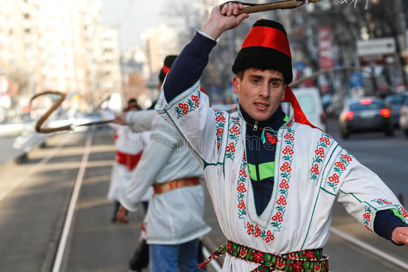 Winter traditions. Bucharest, Romania, December 30, 2012: Carolers dressed in national costumes are snapping the whips in a tram station in Bucharest stock photos