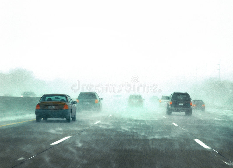 Winter traffic during a snow storm stock photo