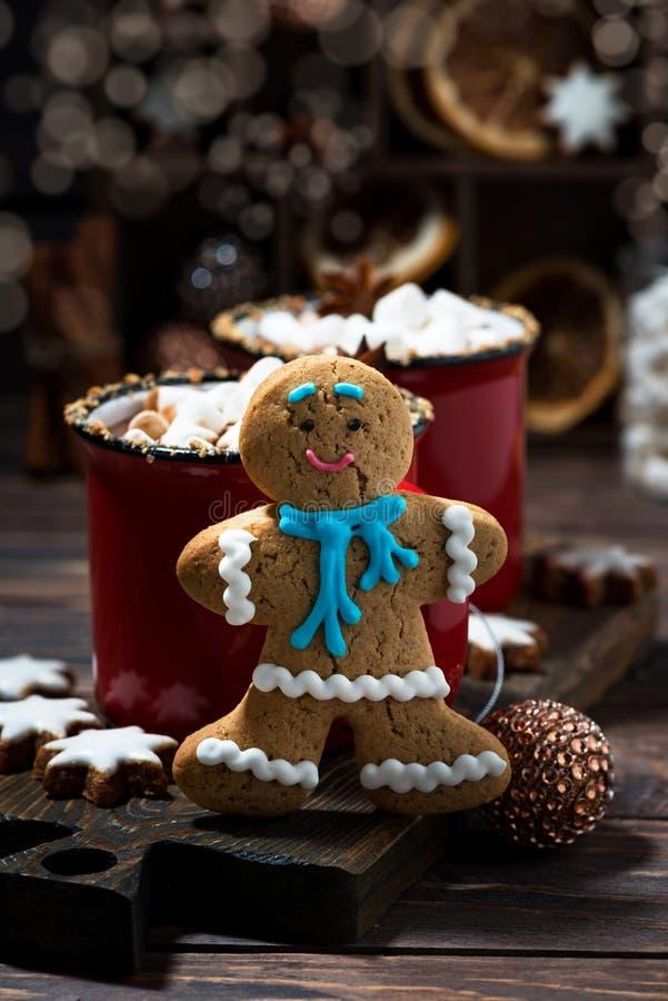 Winter treats, gingerbread man cookies and hot chocolate. Closeup stock photos
