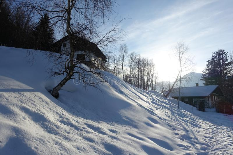 Chalets And Around The Snow Under The Sun royalty free stock image